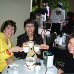 Authors Mary Nethery and Kirby Larson in their first meeting with illustrator Jean Cassels, at Café du Monde, in New Orleans.